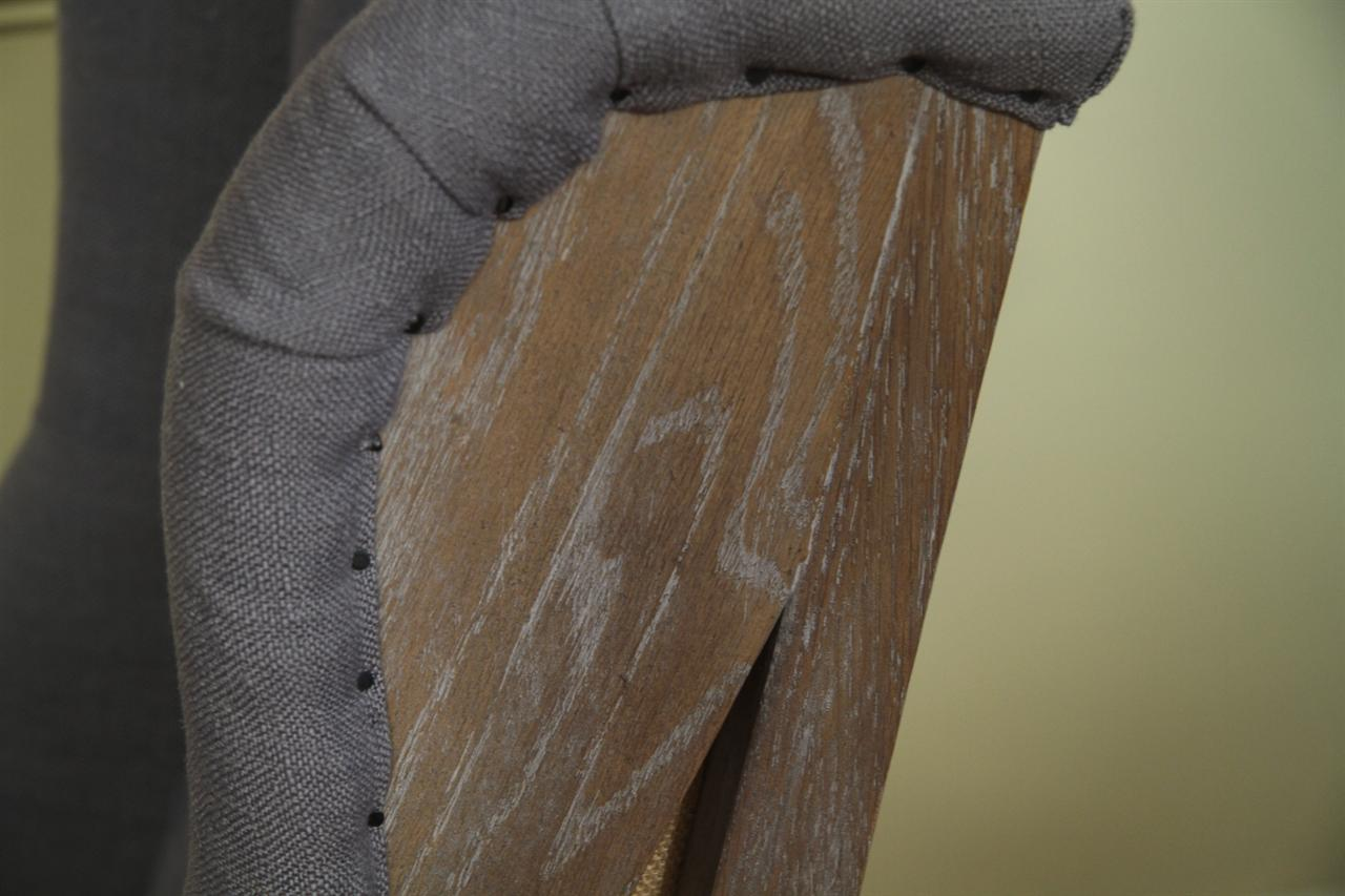 Distressed Wood Frame Makes Up The Wings Of The Chair