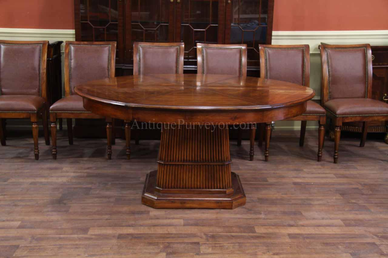 66 Inch Round Solid Walnut Dining Table With Hidden Leaves