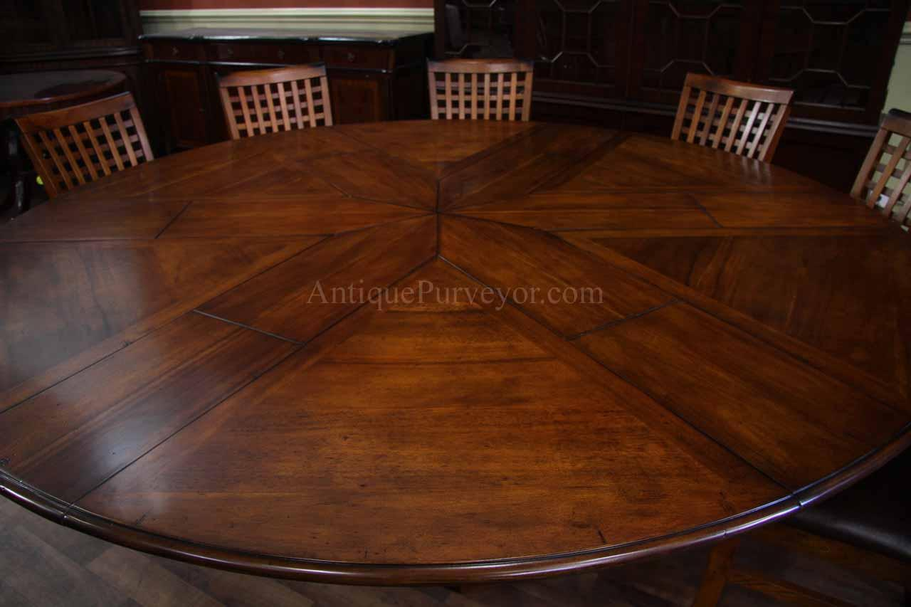 Solid Walnut Round Dining Table With Self Storing Leaves - Walnut color dining table