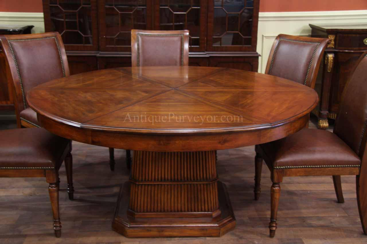 solid walnut round dining table with self storing leaves. Black Bedroom Furniture Sets. Home Design Ideas