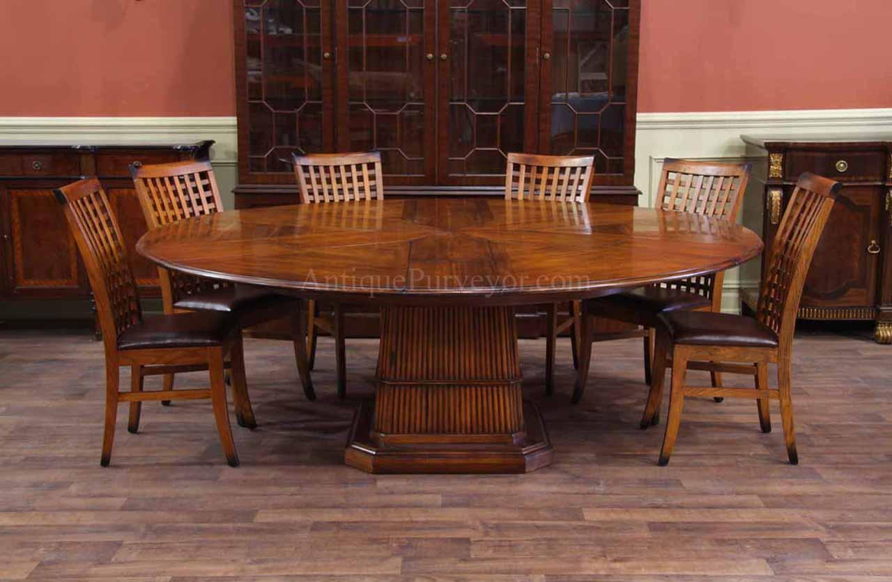 Solid Walnut Round Dining Table with Tropical Pedestal and Hidden Leaves. Solid Walnut Round Dining Table with Self Storing Leaves