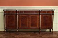 Mahogany dining room sideboard with gold leaf accents and inlaid satinwood banded drawers