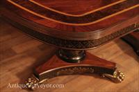 Mahogany double pedestal dining table with brass feet