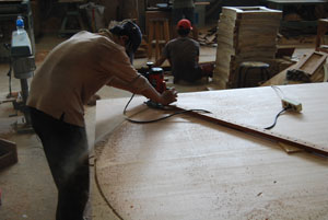 Indonesian mahogany furniture being manufactured, 60 round dining table with perimeter leaves.