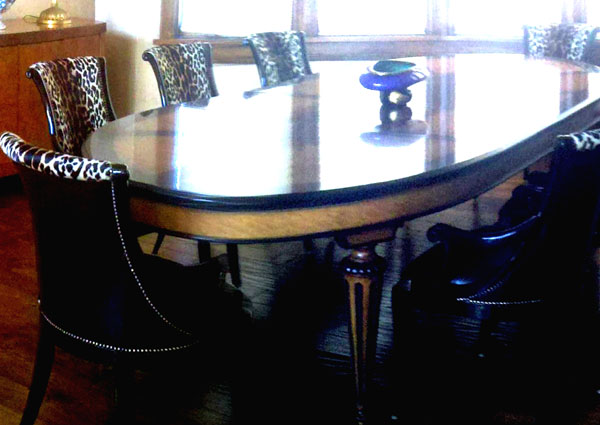 EJ Victor dining table with Maitland Smith upholstered dining chairs. Nice !